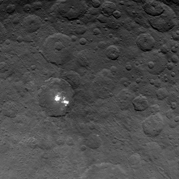 Bright spots on dwarf planet Ceres.  Image courtesy of NASA/JPL-Caltech/UCLA/MPS/DLR/IDA.