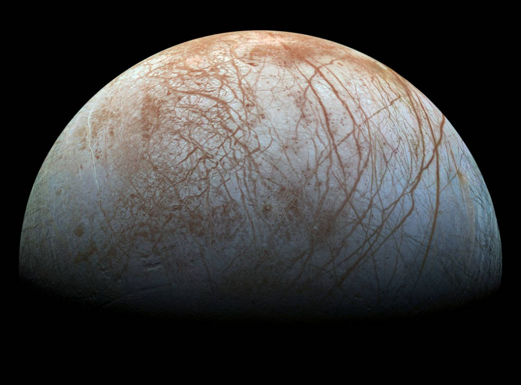 Realistic color image of Europa constructed from mosaic of images taken by NASA's Galileo Probe.  Surface is mostly water ice with red-brown cracks and ridges containing significant amounts of other materials.  Image courtesy of NASA/JPL-Caltech/SETI Institute.